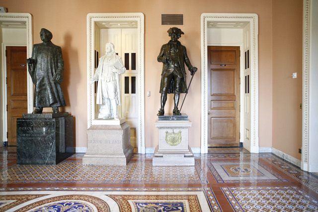 A statue of Patrick A. McCarran of Nevada, left, stands next to ones of Roger Williams of Rhode Island and John Hanson of Maryland near the entrance to the Senate floor on Capitol Hill in Washingt ...