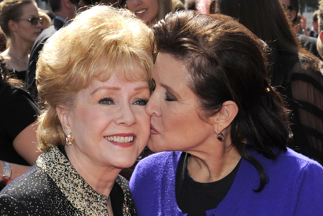 Debbie Reynolds, left, and Carrie Fisher arrive at the Primetime Creative Arts Emmy Awards on Saturday Sept. 10, 2011 in Los Angeles. (Chris Pizzello/AP)