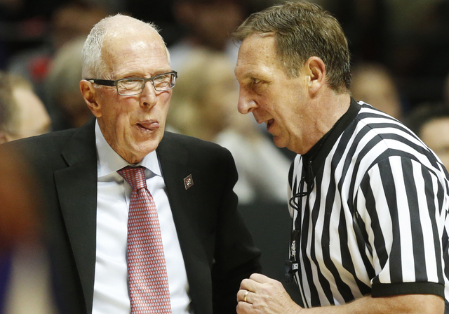 San Diego State coach Steve Fisher speaks with a referee during the second half of an NCAA college basketball game in the NIT men's tournament against Washington, Monday, March 21, 2016, in San Di ...