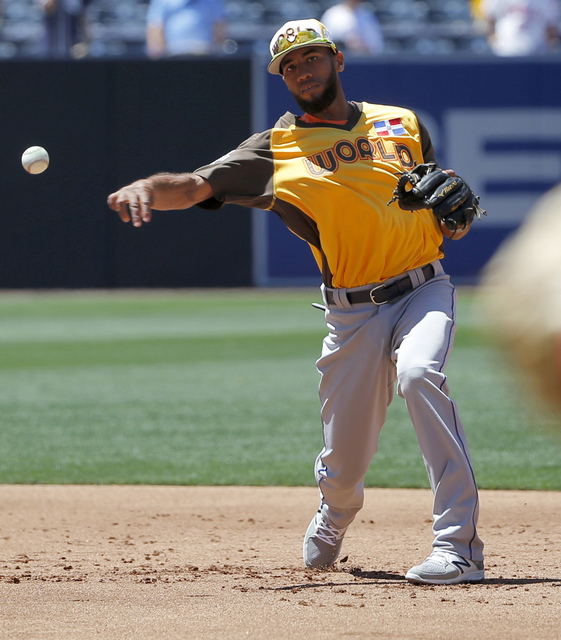 World Team's Amed Rosario, of the New York Mets, fields prior to the All-Star Futures baseball game against the U.S. Team, Sunday, July 10, 2016, in San Diego. (Lenny Ignelzi/AP)