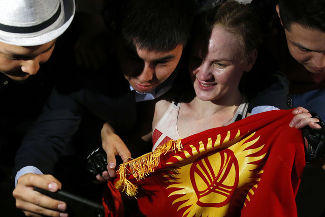 Valentina Shevchenko, of Kyrgyzstan, celebrates with fans after defeating Holly Holm during a women's bantamweight mixed martial arts bout in Chicago, Saturday, July 23, 2016. (AP Photo/Nam Y. Huh)