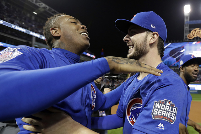 Chicago Cubs' Aroldis Chapman, left, and Kris Bryant celebrate after Game 7 of the Major League Baseball World Series against the Cleveland Indians Thursday, Nov. 3, 2016, in Cleveland. The Cubs w ...