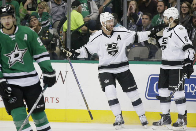 Los Angeles Kings center Jeff Carter (77) celebrates his goal with teammate Drew Doughty (8) as Dallas Stars center Jason Spezza (90) skates off during the first period of an NHL hockey game in Da ...