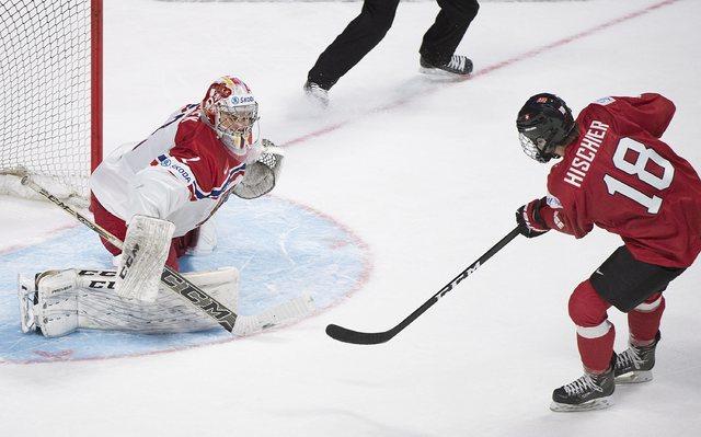 Switzerland's Nico Hischier (18) scores on Czech Republic's goaltender Jakub Skarek during the overtime period inpreliminary round IIHF World Junior Championship hockey action in Montreal, Tuesday ...