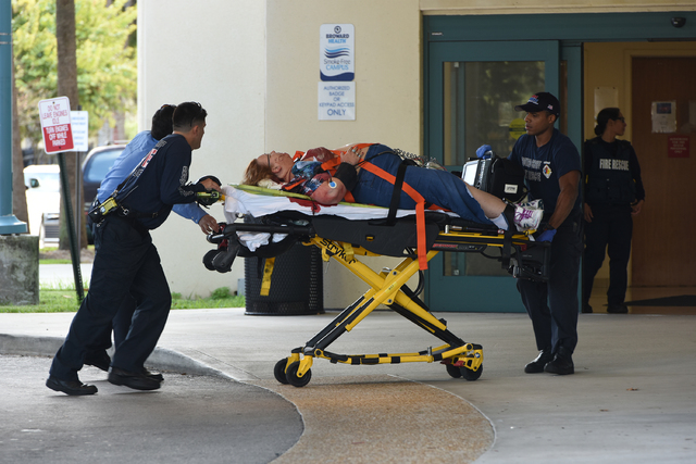 A shooting victim is taken into Broward Health Trauma Center in Fort Lauderdale, Fla., Friday, Jan. 6, 2017.  Authorities said multiple people have died after a lone suspect opened fire at the Ft. ...