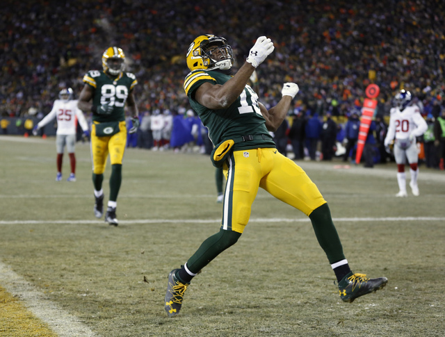 Green Bay Packers wide receiver Randall Cobb (18) celebrates after scoring a touchdown during the second half of an NFC wild-card NFL football game against the New York Giants, Sunday, Jan. 8, 201 ...