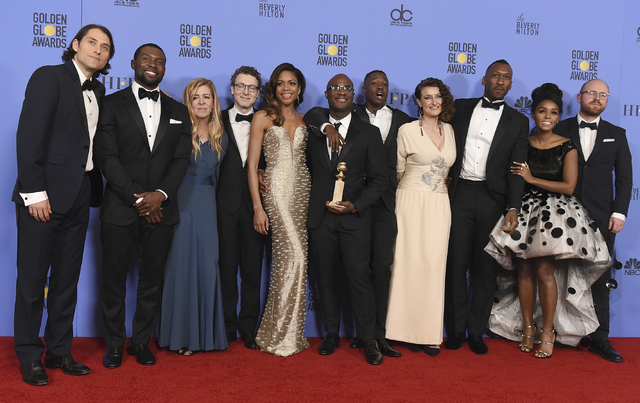 """The cast and crew of """"Moonlight"""" pose in press room with the award for best motion picture - drama at the 74th annual Golden Globe Awards at the Beverly Hilton Hotel on Sunday, J ..."""