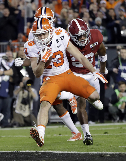 Clemson's Hunter Renfrow breaks away for a touchdown catch during the second half of the NCAA college football playoff championship game against Alabama Monday, Jan. 9, 2017, in Tampa, Fla. (AP Ph ...