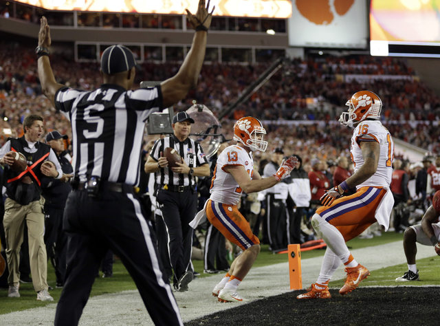 Clemson's Hunter Renfrow celebrates after catching a touchdown during the second half of the NCAA college football playoff championship game against Alabama Tuesday, Jan. 10, 2017, in Tampa, Fla.  ...