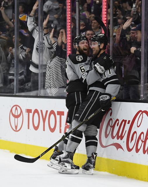Los Angeles Kings center Jeff Carter, right, celebrates his gone-inning goal with defenseman Jake Muzzin during the overtime period of an NHL hockey game against the Winnipeg Jets, Saturday, Jan.  ...
