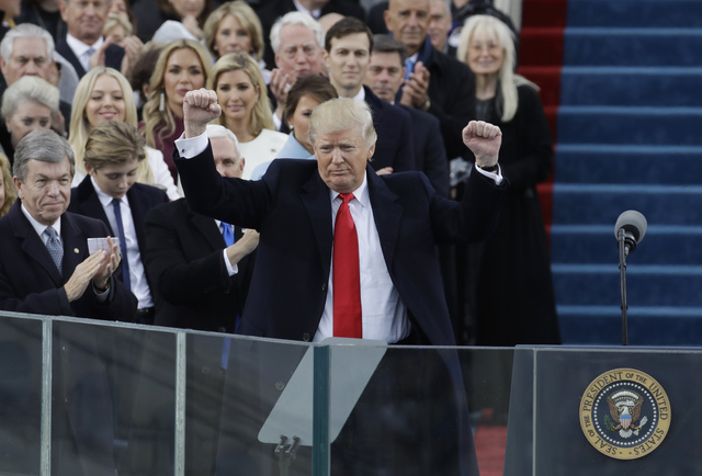 President Donald Trump pumps his fist after delivering his inaugural address after being sworn in as the 45th president of the United States during the 58th Presidential Inauguration at the U.S. C ...