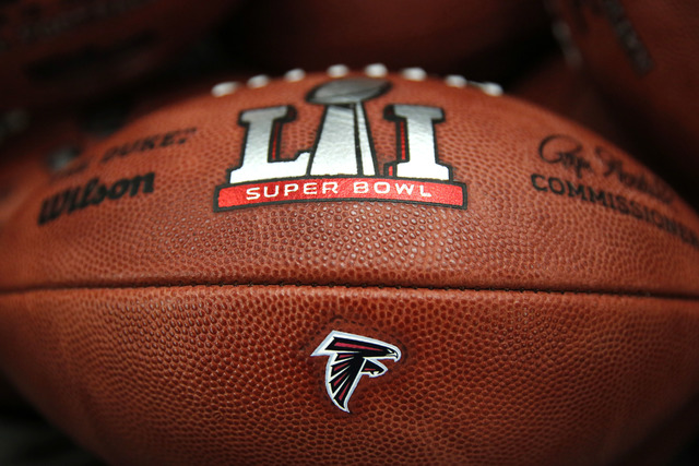 The Atlanta Falcons' NFL Super Bowl LI game ball is finished with the team's logo affixed to it at the Wilson Sporting Goods factory, Monday, Jan. 23, 2017, in Ada, Ohio. (Charles Rex Arbogast/AP)