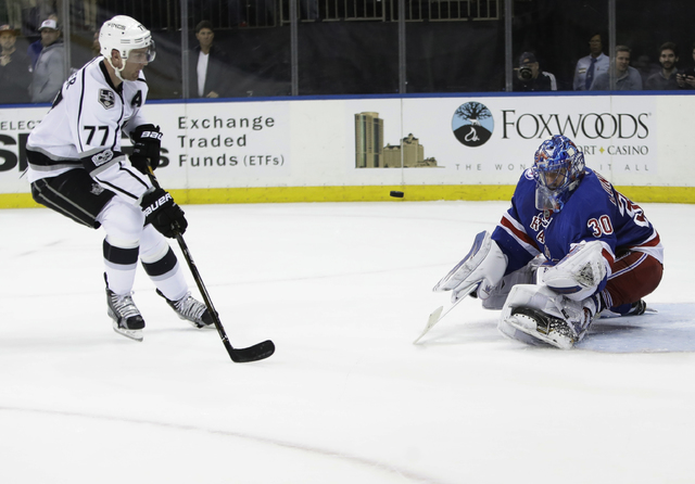 Los Angeles Kings' Jeff Carter (77) attempts to score as New York Rangers goalie Henrik Lundqvist (30), of Sweden, stops a shot on the goal during the first period of an NHL hockey game, Monday, J ...