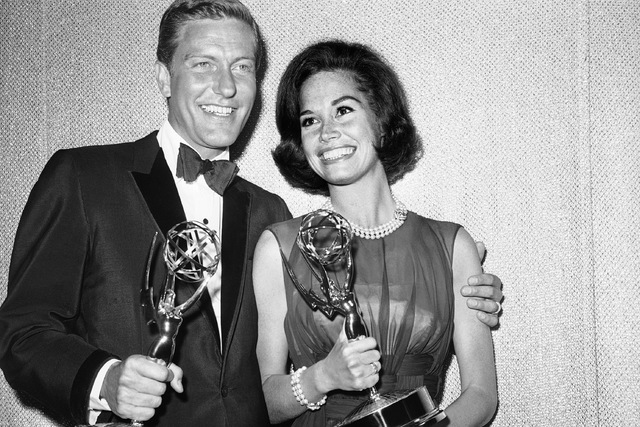 """This May 25, 1964 file photo shows Dick Van Dyke, left, and Mary Tyler Moore, co-stars of """"The Dick Van Dyke Show"""" backstage at the Palladium with their Emmys for best actor and actress in a serie ..."""