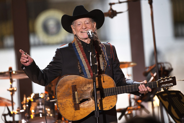 """Singer Willie Nelson performs during an """"In Performance at the White House"""" series event on the South Lawn of the White House, Thursday, Nov. 6, 2014, in Washington. (AP Photo/Jacquelyn Martin)"""