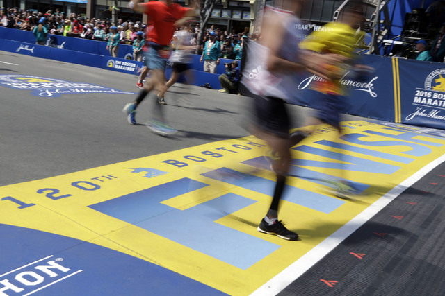 Runners cross the finish line of the 120th Boston Marathon on Monday, April 18, 2016, in Boston. (Elise Amendola/AP)