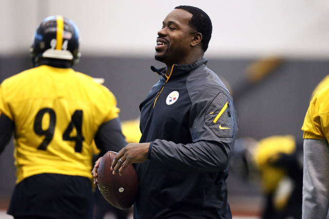 Pittsburgh Steelers assistant coach Joey Porter runs a drill during the NFL football teams' practice in Pittsburgh, Wednesday, Jan. 13, 2016. (AP Photo/Gene J. Puskar)
