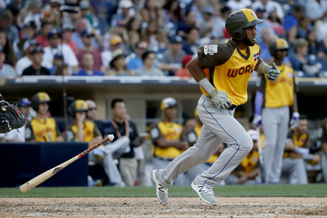 World Team's Amed Rosario runs out a base hit against the U.S. Team during the ninth inning of the All-Star Futures baseball game, Sunday, July 10, 2016, in San Diego. (Lenny Ignelzi/AP)