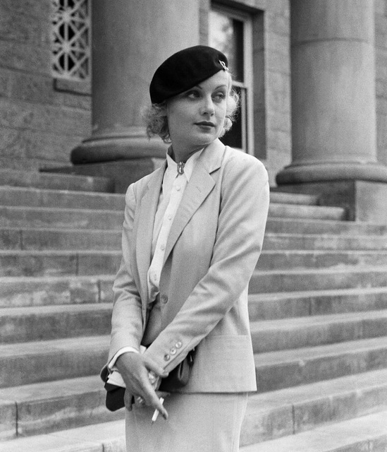Carole Lombard, well known screen actress shown on the courthouse steps at Carson City, Nev., Aug. 18,1933 following her divorce from her husband, William Powell. She testified that he was &qu ...