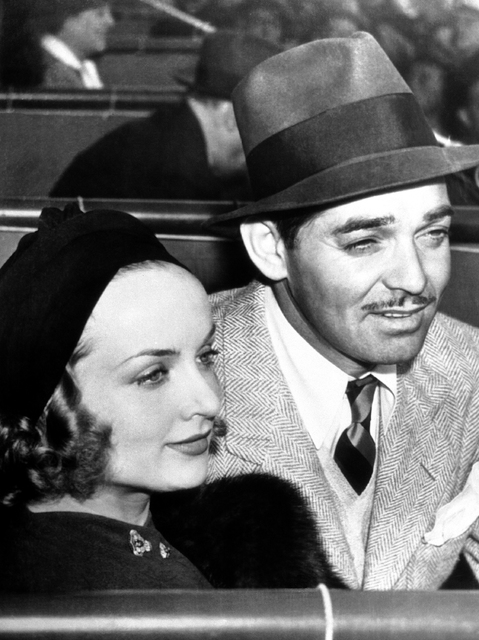 Carole Lombard and Clark Gable, film stars, in their box at Santa Anita Park, on Feb. 22, 1938, as they attended the 50,000 dollars Santa Anita Derby. (AP Photo)