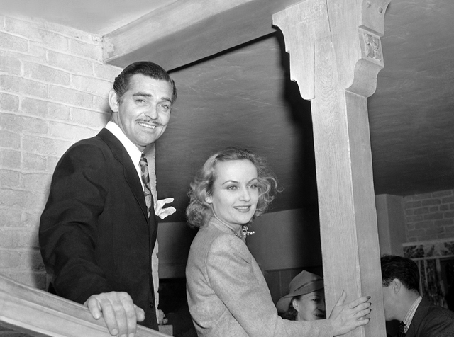 American actor Clark Cable and American actress Carole Lombard at the home of Carols mother, on their return to Hollywood after they had eloped to Kingman, Arizona, for their romantic marriage, on ...