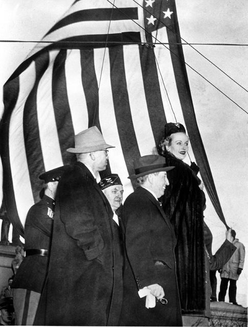 Actress Carole Lombard, right, is seen with Motion Picture Producers and Distributors of America Will Hays, center, and Indiana Defense Savings chairman Eugene D. Pulliam, left, as they opened a d ...