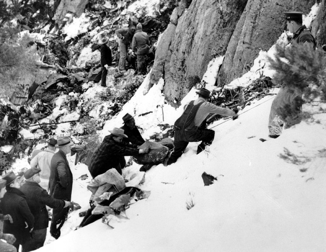 Carole Lombard's blanket-wrapped body is removed from the crash site on Potosi Mountain on Jan. 18, 1942. (AP Photo)