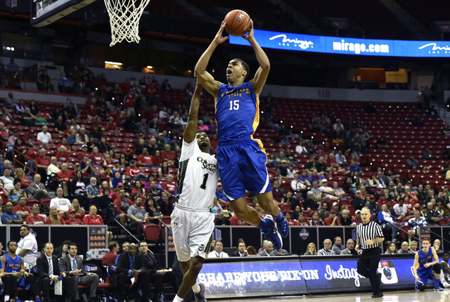 San Jose State's Brandon Clarke (15) shoots against Colorado State's Antwan Scott (1) during the second half of an NCAA college basketball game at the Mountain West Conference men's tournament Wed ...