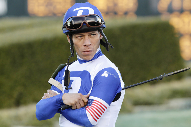 In this photo taken Feb. 17, 2014, jockey Norberto Arroyo Jr., waits in the infield at Oaklawn Park in Hot Springs, Ark., before running in the Southwest Stakes horse race. (Danny Johnston/AP)