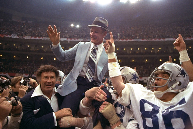 In this Jan. 15, 1978, file photo, Dallas Cowboys head coach Tom Landry is given a victory ride after the team defeated the Denver Broncos in NFL football's Super Bowl XII in New Orleans. (File/AP)