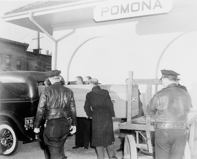A casket containing the body of actress Carole Lombard, is loaded into a hearse after arriving by train in Pomona, Calif., Jan. 21, 1942. Miss Lombard was one of 22 victims of an airplane crash ne ...