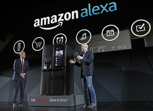 IMAGE DISTRIBUTED FOR LG ELECTRONICS - LG Electronics' vice president David VanderWaal and Amazon Echo vice president Mike George present the LG Smart InstaView Door-in-Door Refrigerator to ...