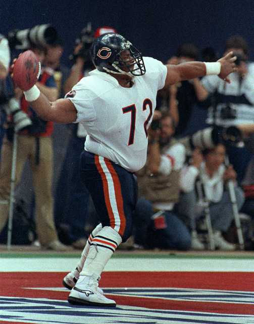 "FILE - In this Jan. 26, 1986 file photo, Chicago Bears' William ""The Refrigerator"" Perry spikes the ball after scoring a touchdown in Super Bowl XX against the New England Patrio ..."