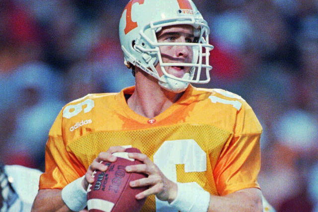Tennessee quarterback Peyton Manning looks downfield for a receiver Saturday, Aug. 30, 1997, against Texas Tech in Knoxville. The Vols won 52-17 as Manning threw for a five touchdowns. Tennessee p ...