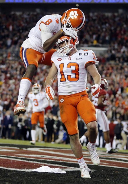 Clemson's Hunter Renfrow is congratulated by teammate Deon Cain after catching a touchdown pass during the second half of the NCAA college football playoff championship game against Alabama Monday ...