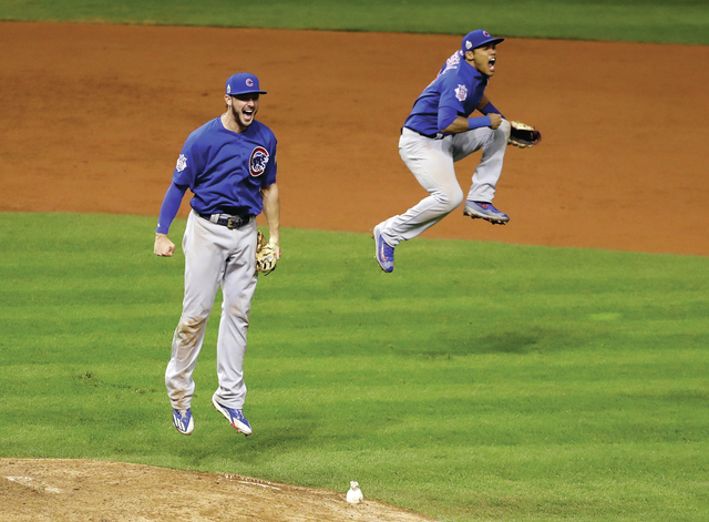 Chicago Cubs' Kris Bryant, left, and Addison Russell celebrate after Game 7 of the Major League Baseball World Series against the Cleveland Indians Thursday, Nov. 3, 2016, in Cleveland. The Cubs w ...
