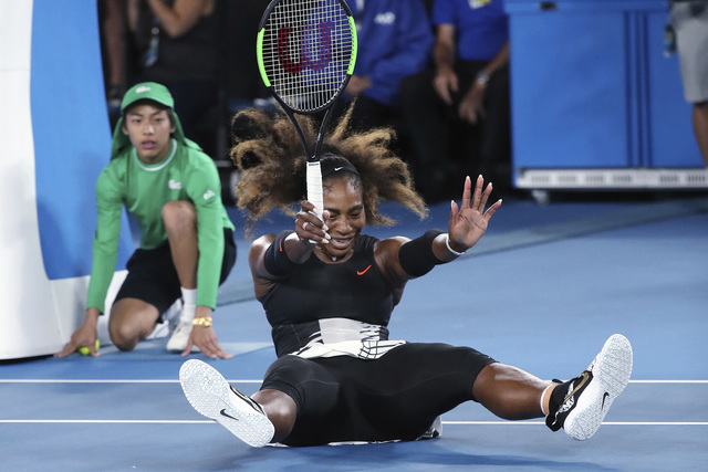 United States' Serena Williams falls to the court as she celebrates defeating her sister, Venus, in the women's singles final at the Australian Open tennis championships in Melbourne, Australia, S ...