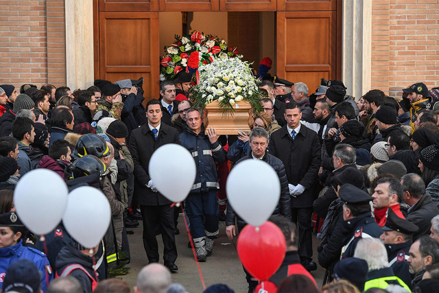 The coffin of Gabriele D'Angelo, one of the victims of the avalanche thata buried the Hotel Rigopiano, is carried outside St. Massimiliano Kolbe Church, during the funeral in Penne, central Italy, ...