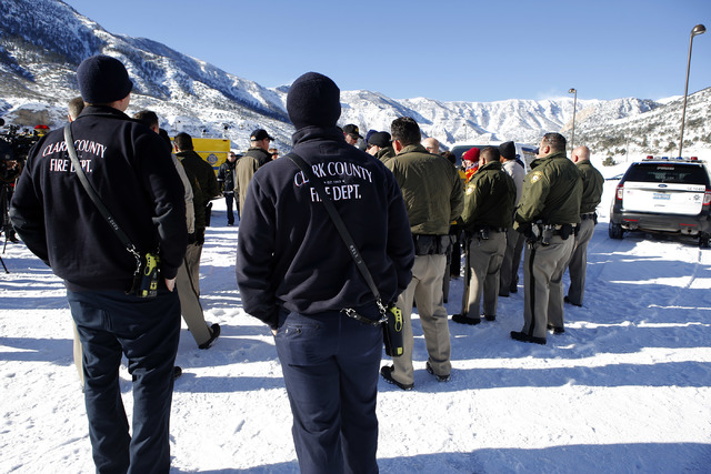 First responders meet at Mount Charleston before going door to door for a voluntary evacuation on Wednesday, Jan. 25, 2017, in Las Vegas.  Clark County announced a voluntary evacuation notice for  ...