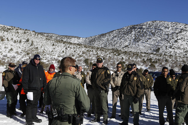 First responders receive instruction at Mount Charleston before going door to door for a voluntary evacuation on Wednesday, Jan. 25, 2017, in Las Vegas.  Clark County announced a voluntary evacuat ...