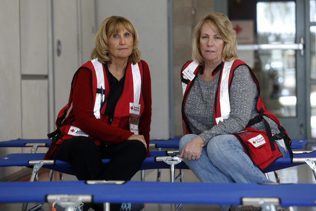Red Cross volunteers Vicki Kallman, left, and Patricia Vaszil in a room at the Centennial Hills Community Center YMCA where families can seek shelter after a voluntary evacuation from areas of Mou ...