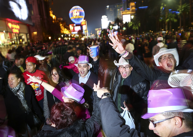 New Year's Eve revelers celebrate along the Las Vegas Strip moments before the New Year on Saturday, Dec. 31, 2016. (Chase Stevens/Las Vegas Review-Journal) @csstevensphoto