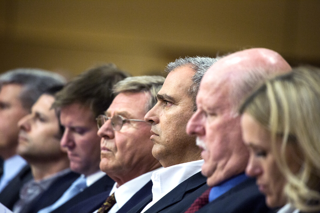 Developer Yohan Lowie, third from right, CEO and founder of EHB Companies., listens during the Las Vegas City Council public hearing on the controversial large-scale development on the Badlands Go ...
