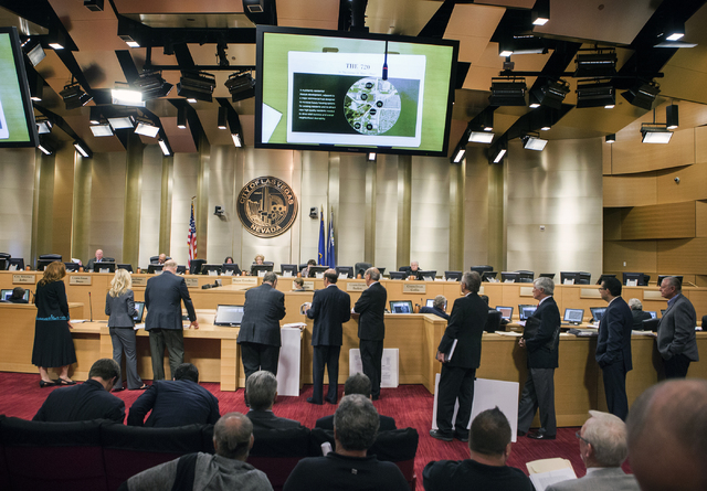 People stand to speak during public comment during the Las Vegas City Council public hearing on the controversial large-scale development on the Badlands Golf Course on Wednesday, Nov.16, 2016. Je ...