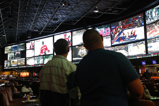 Betters looks at a tv screen before the Westgate sports book posted nearly 400 Super Bowl prop bets on Thursday, Jan. 26, 2017, in Las Vegas. (Christian K. Lee/Las Vegas Review-Journal) @chrisklee ...