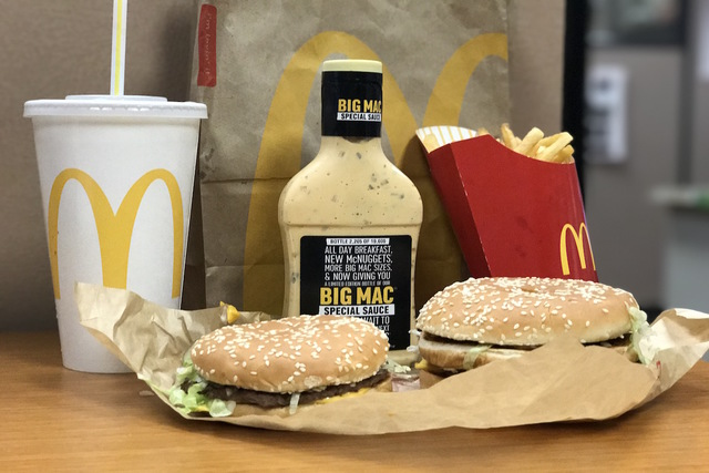 McDonald's Big Mac Special Sauce bottle is shown with the Mac Jr. and Grand Mac burgers. (Elaine Wilson/Las Vegas Review-Journal)