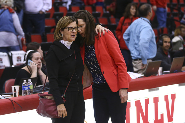 UNLV athletic director Tina Kunzer-Murphy, left, embraces UNLV coach Kathy Olivier after a basketball game against Colorado State at Cox Pavilion in Las Vegas on Thursday, Dec. 29, 2016. UNLV lost ...