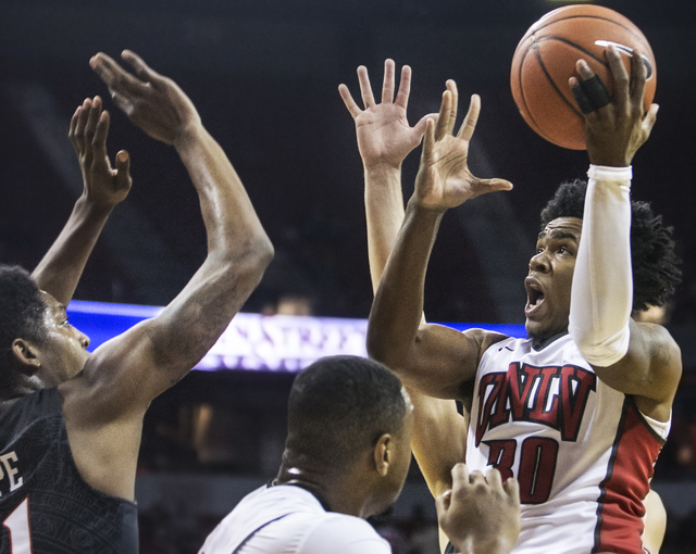 UNLV's Jovan Mooring (30) drives past San Diego State's Malik Pope (21) during the Rebels home matchup with the Aztecs on Tuesday, Jan. 17, 2017, at the Thomas & Mack Center, in Las Vegas. Ben ...