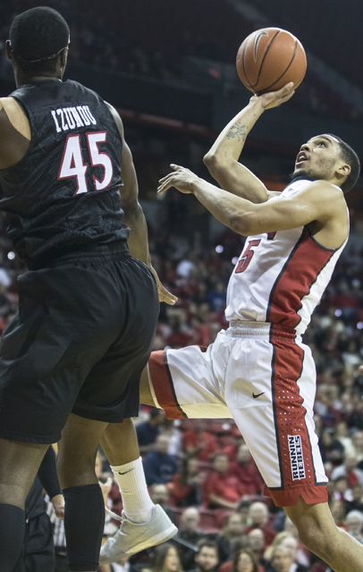 UNLV's Jalen Poyser (5) shoots over San Diego State's Valentine Izundu (45) during the Rebels home matchup with the Aztecs on Tuesday, Jan. 17, 2017, at the Thomas & Mack Center, in Las Vegas. ...