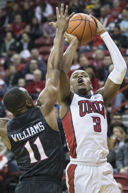 UNLV's Tyrell Green (3) shoots a baseline jump shot over San Diego State's D'Erryl Williams (11) during the Rebels home matchup with the Aztecs on Tuesday, Jan. 17, 2017, at the Thomas & Mack  ...